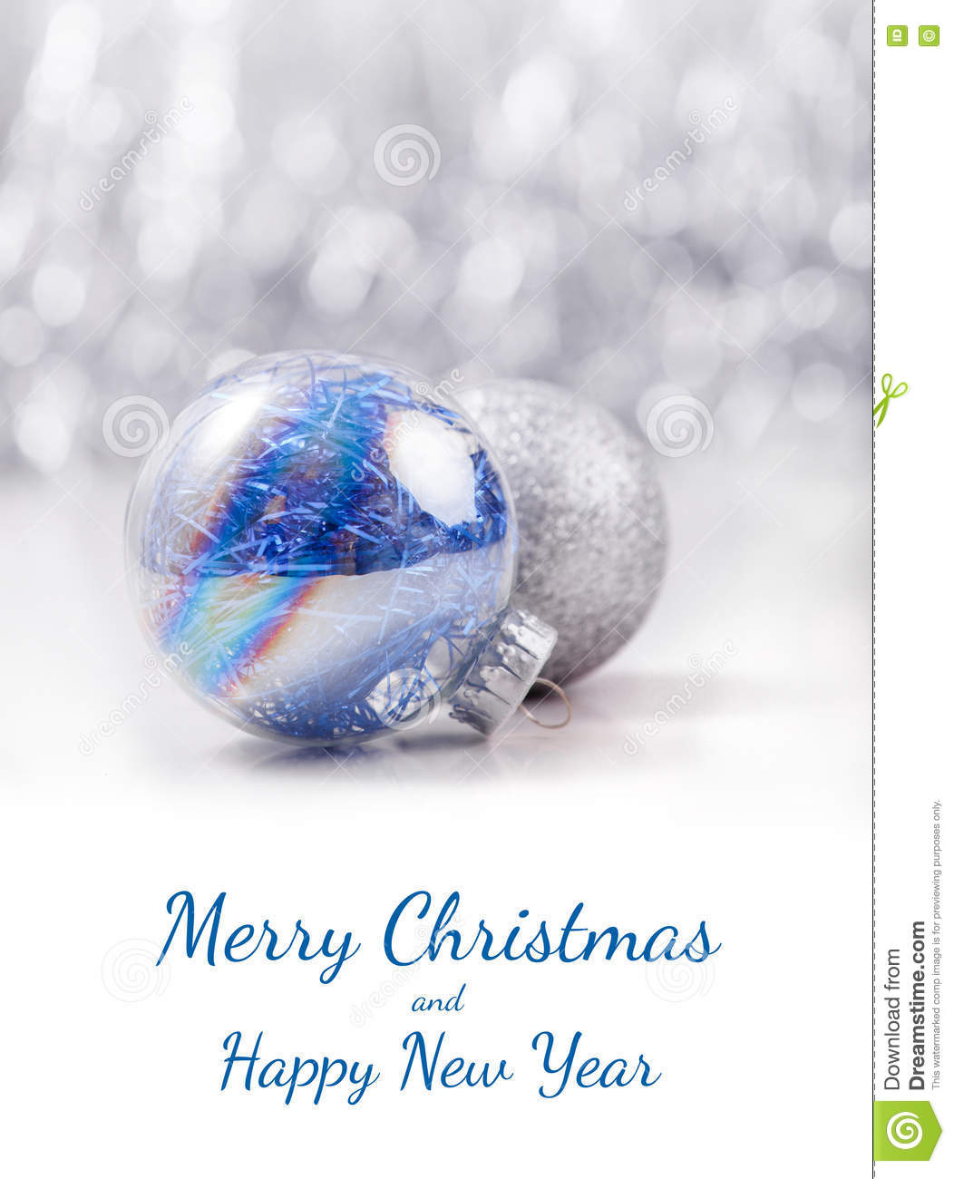 Silver and Blue Christmas ornaments balls on glitter bokeh background with space for text. Xmas and Happy New Year