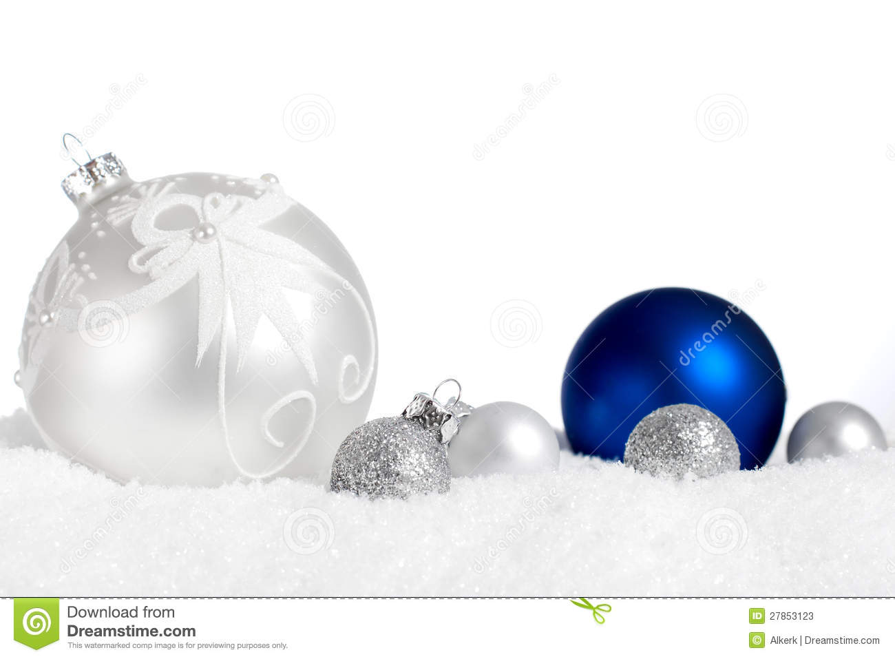 silver and blue ornaments in snow stock photos