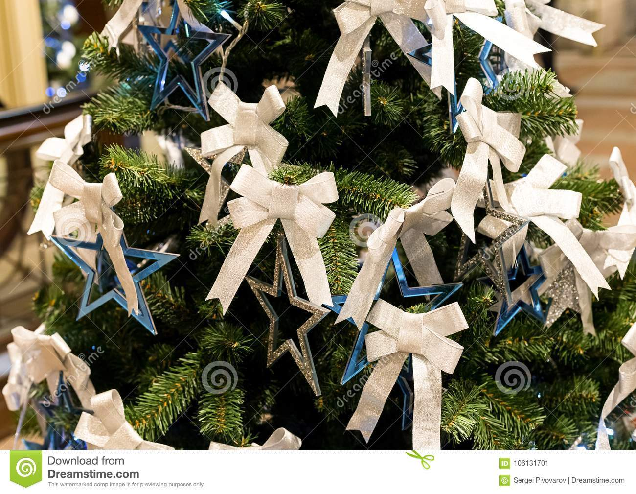 Silver Blue Star And A White Ribbon On A Festive Christmas Tree Decoration Element Christmas Stock Image Image Of Color Background 106131701