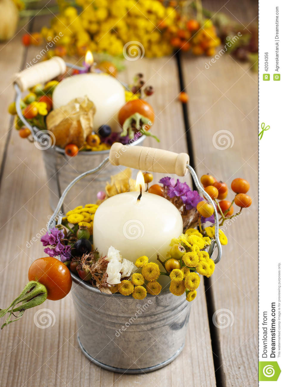 Silver bucket with autumn flowers and other plants.