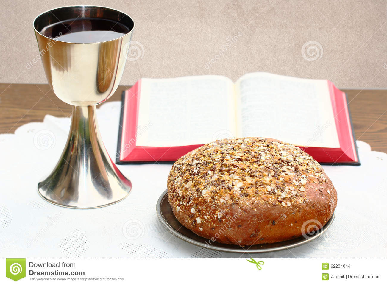 Silver Chalice, Open Bible And Bread Stock Photo - Image of
