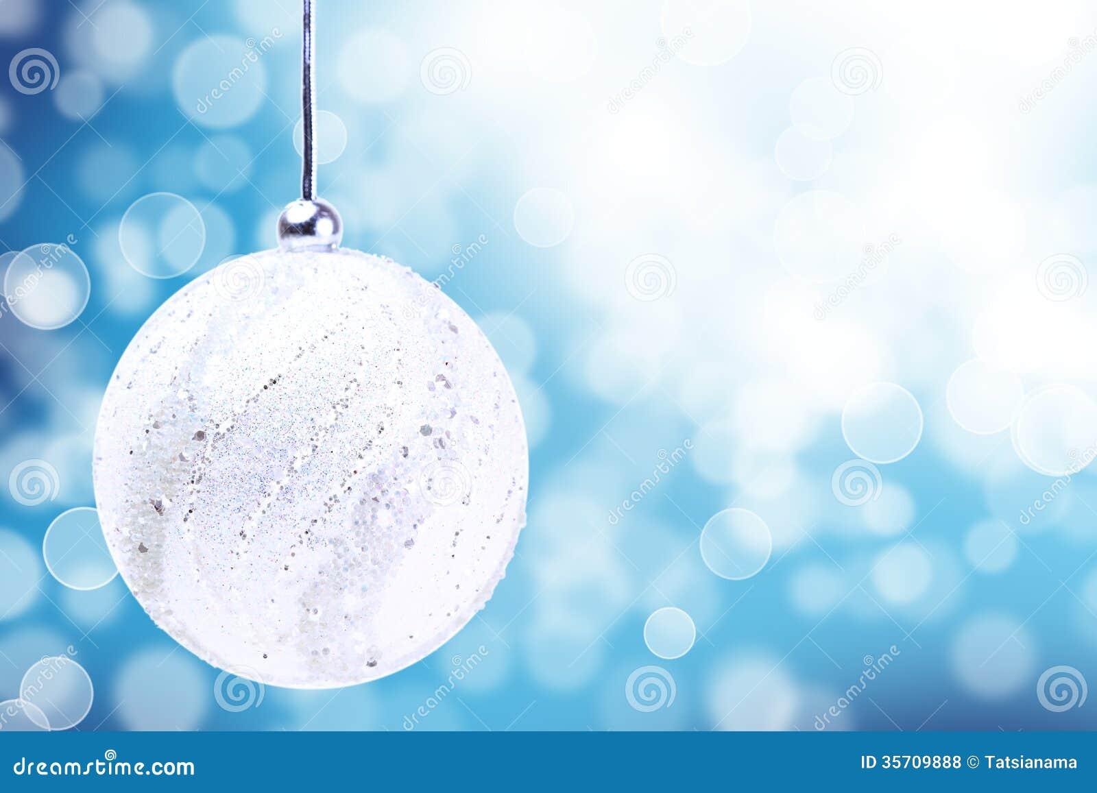 Silver Christmas Ball Ornament Over Elegant Grunge Blue White Light Bokeh Crystal Background