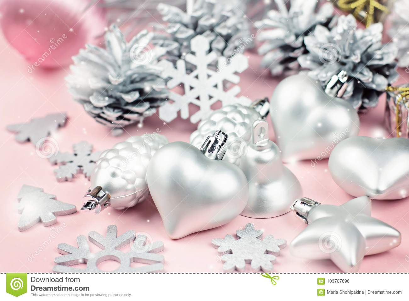 Pastel Christmas Ornaments.Silver Christmas Ornaments Close Up On A Pastel Background