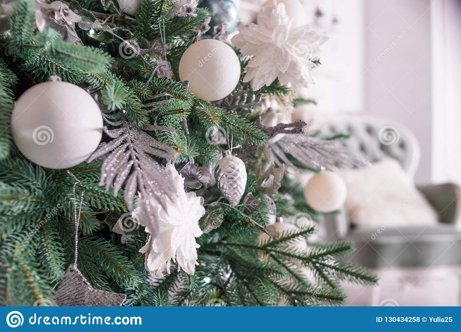 Expensive Christmas Ornaments.Silver Christmas Ornaments Hanging On Fir Tree Section Of A