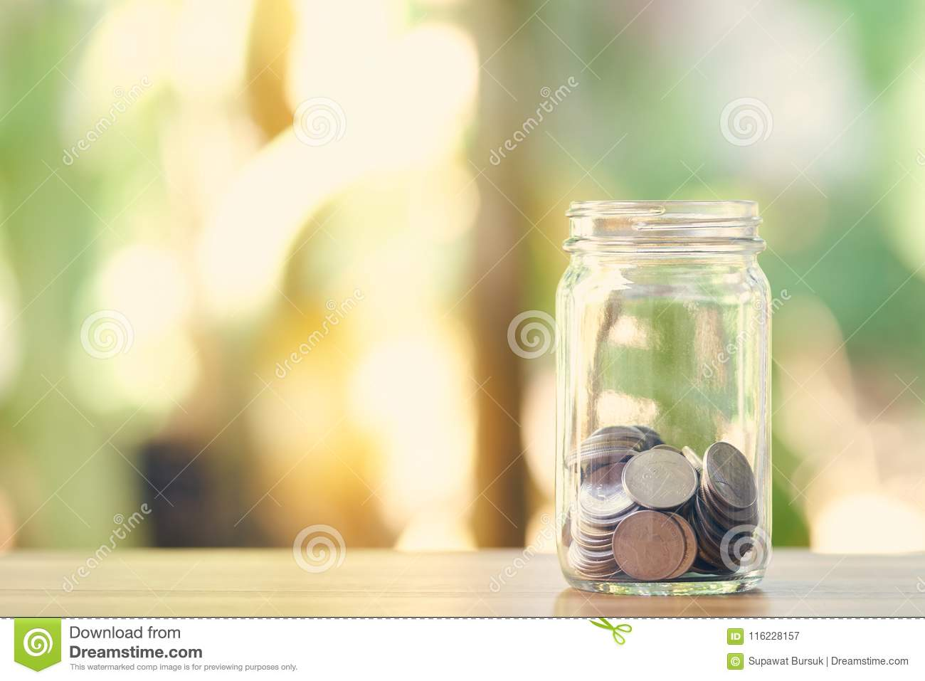 Silver coin in a dozen glasses. Money Saving Media Long-term investment Good money management. as background business concept and