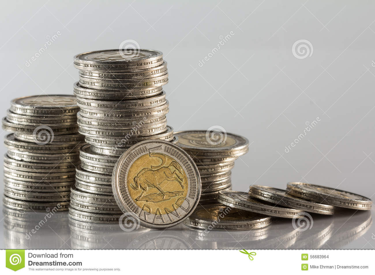 Silver Coins Piled Showing Side View And One Coin Value