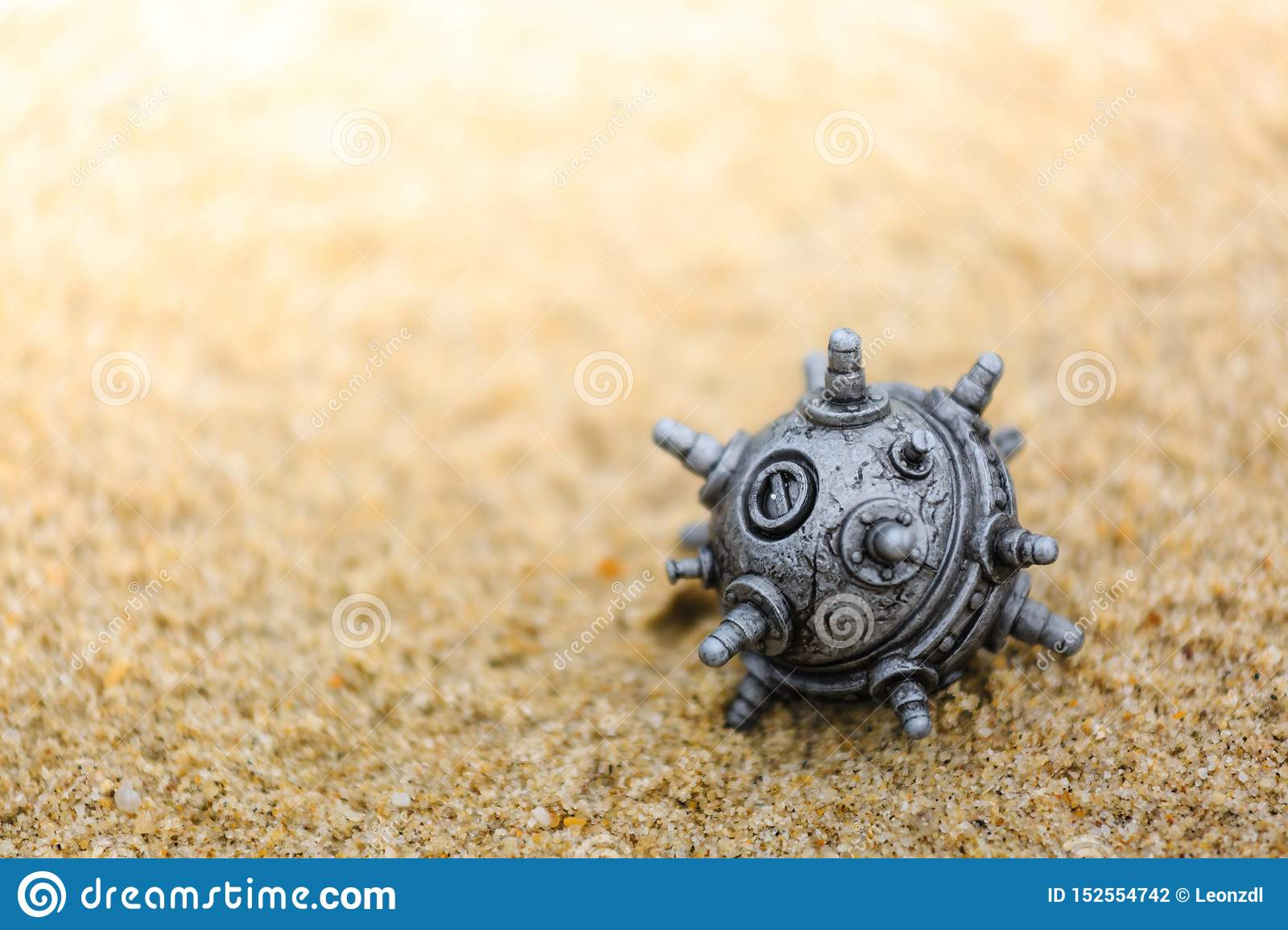 Silver color mine toy on the sands