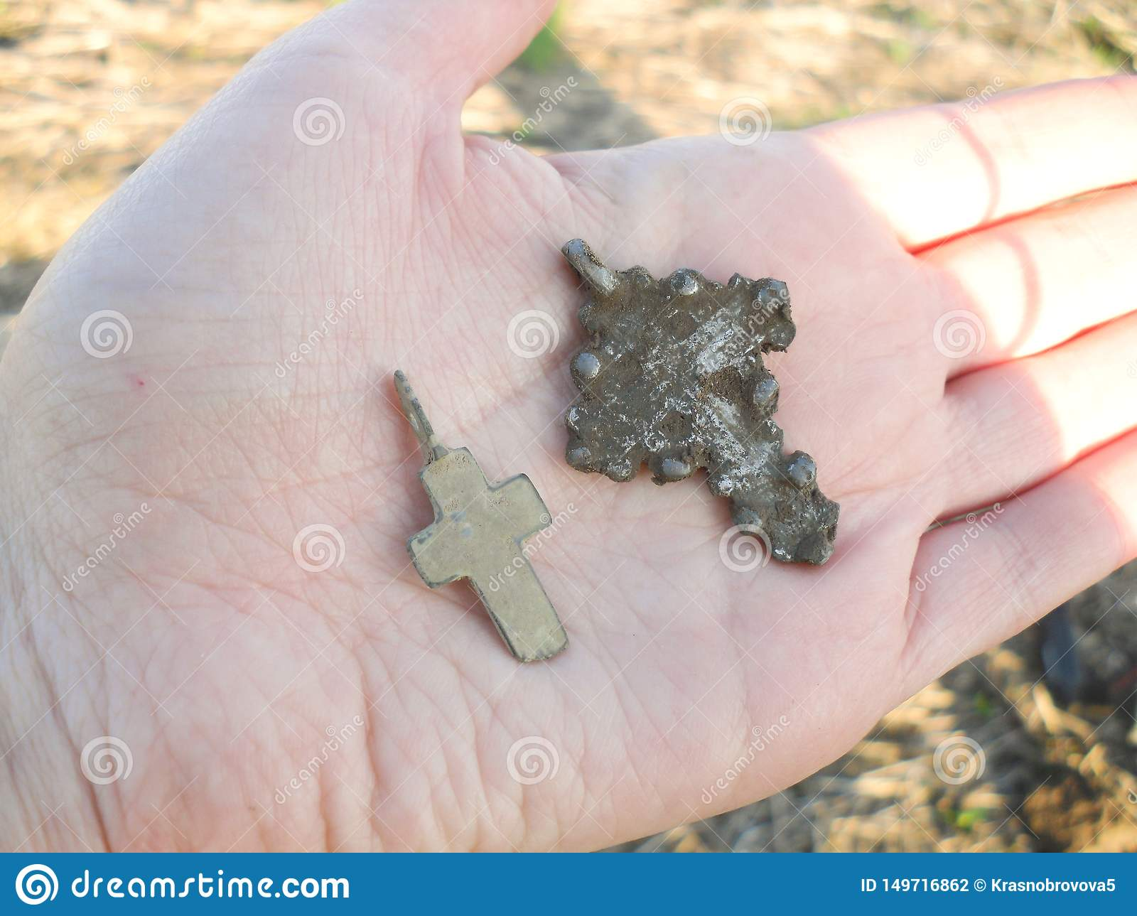 Silver cross in hand found while metal detecting