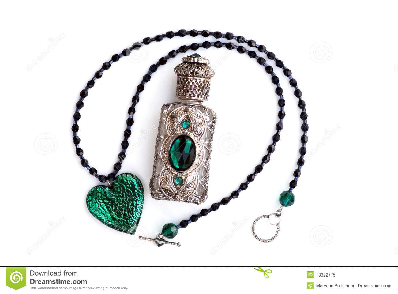 Silver & Crystal Perfume Bottle & Heart Necklace Stock Image