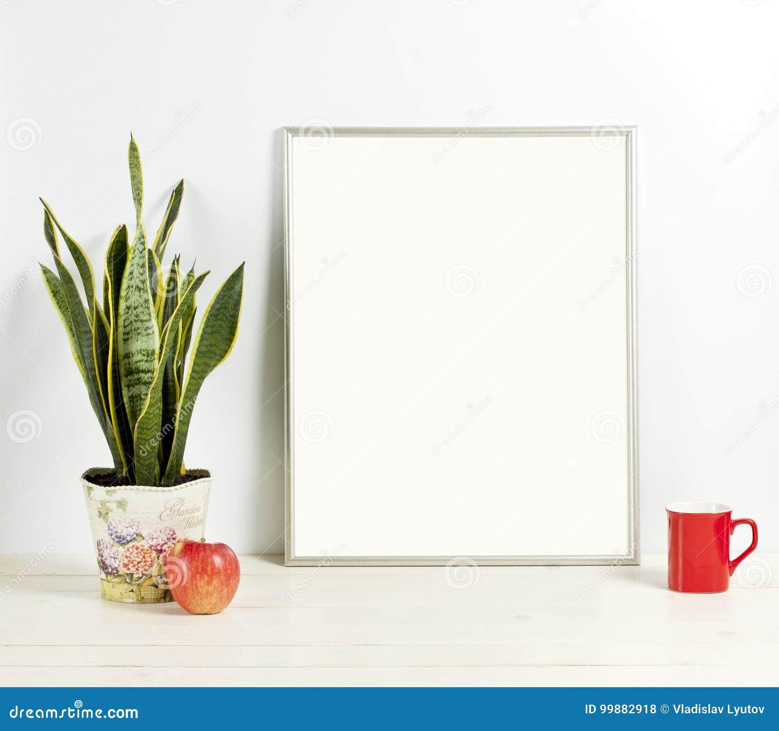 Silver Frame Mockup With Plant Pot Mug And Apple On Wooden Shel