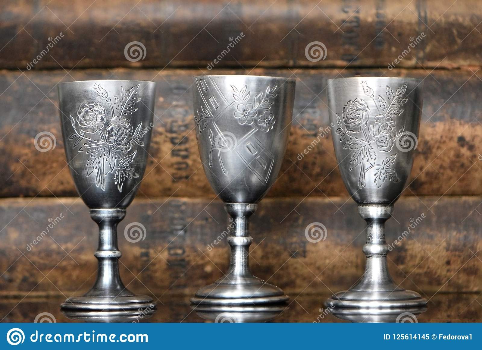Silver glasses on the background of old books