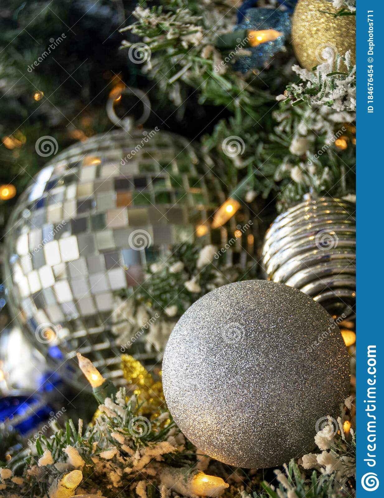 Silver Gold And Blue Christmas Ornaments On A Christmas Tree Stock Photo Image Of Decor Evening 184676454