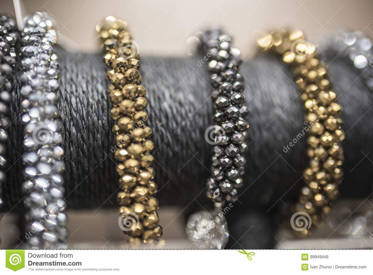 Silver and gold bracelets in defocus