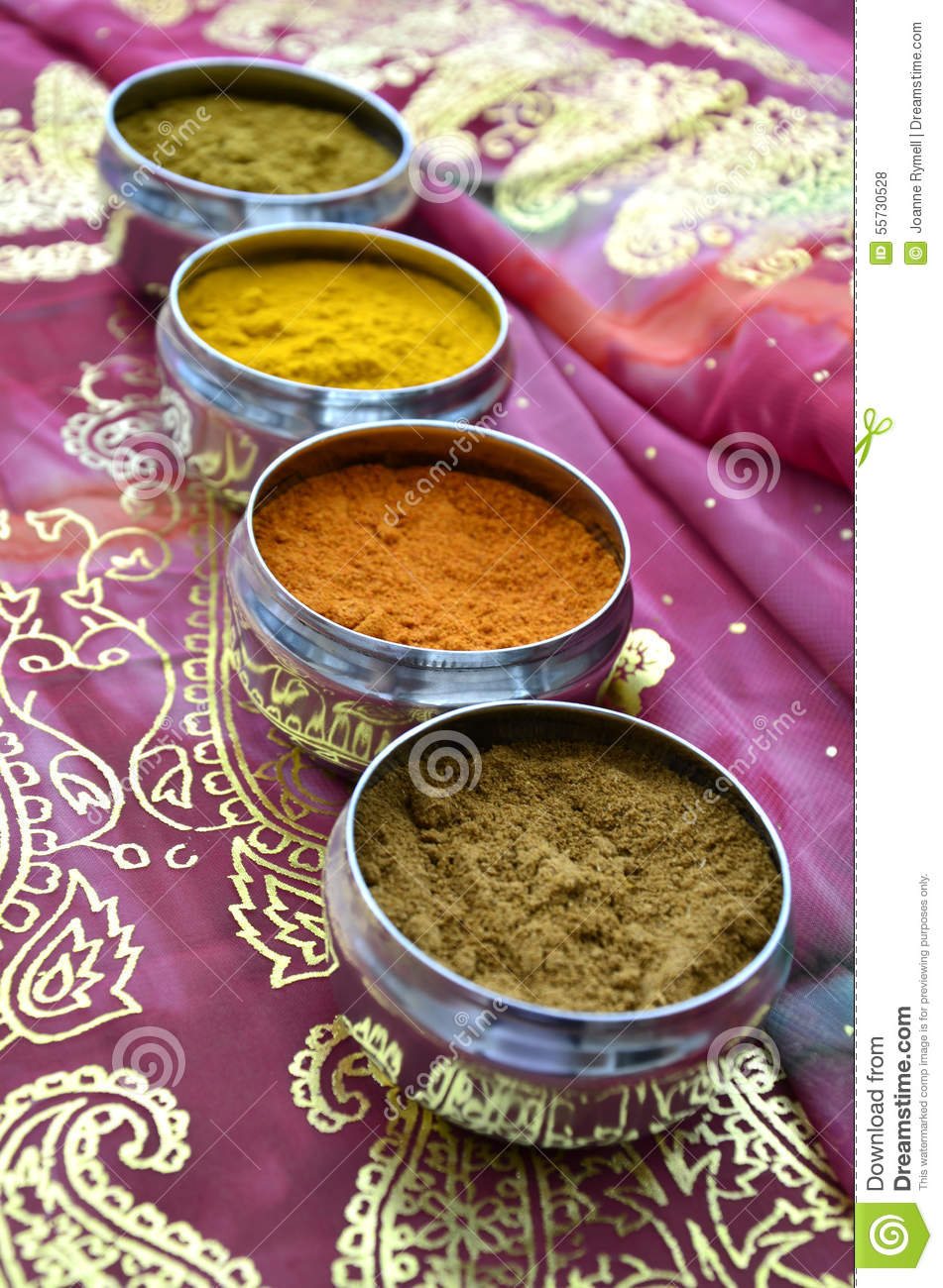 silver indian spice pots on pink gold sari stock photo image