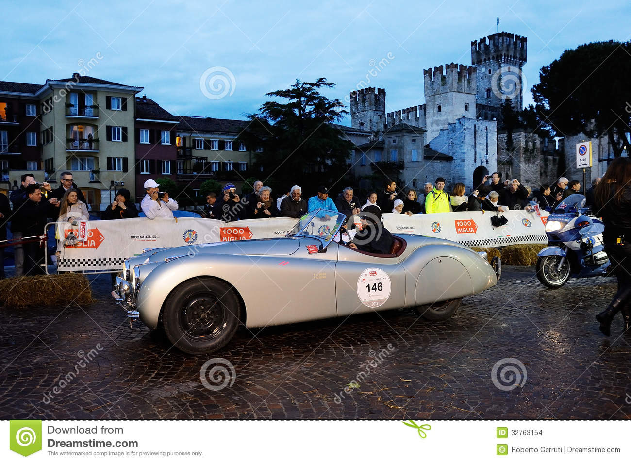 Silver Jaguar XK120 Alloy during the 1000 Miglia, in Sirmione