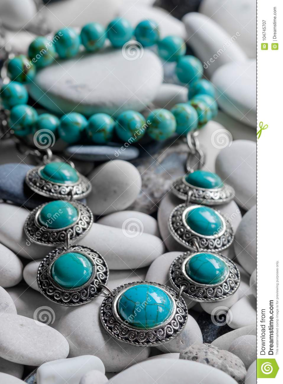 Silver jewelry on pebbles