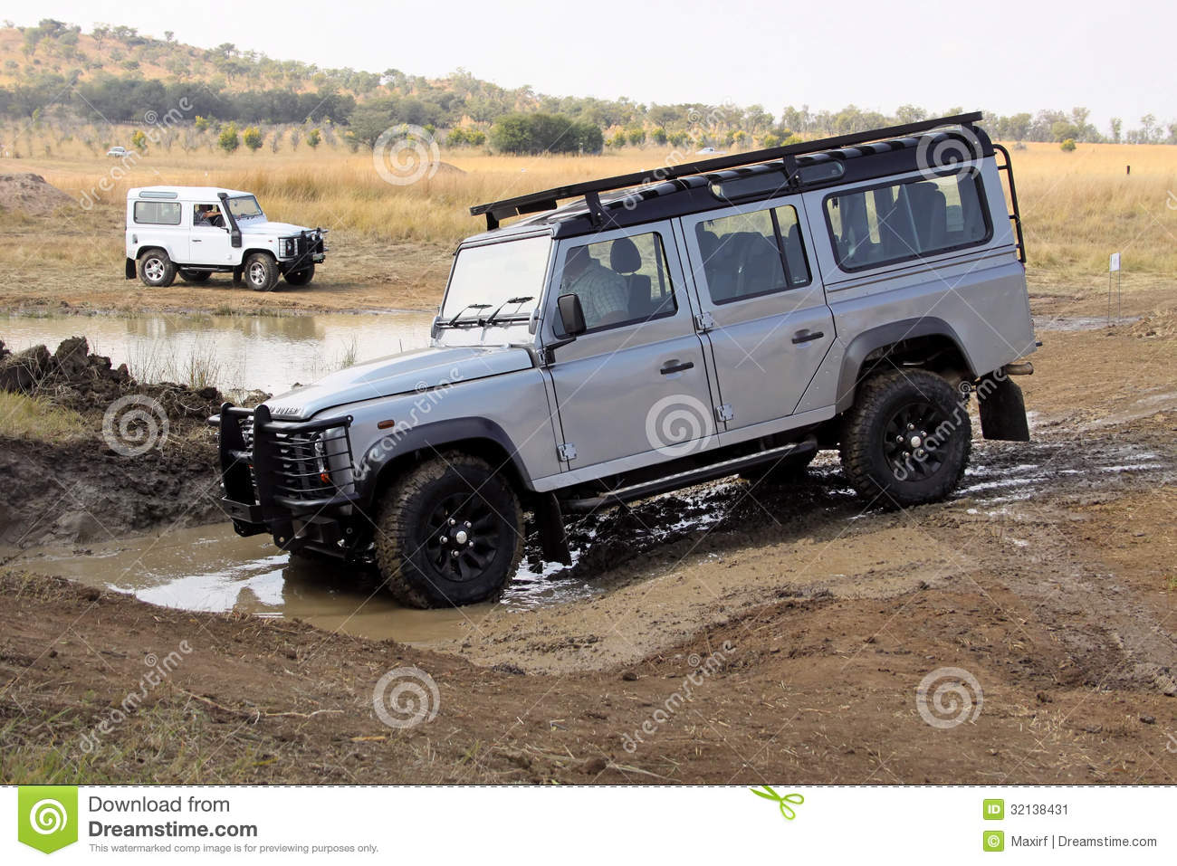 silver land rover defender 110 sw on 4x4 course editorial. Black Bedroom Furniture Sets. Home Design Ideas