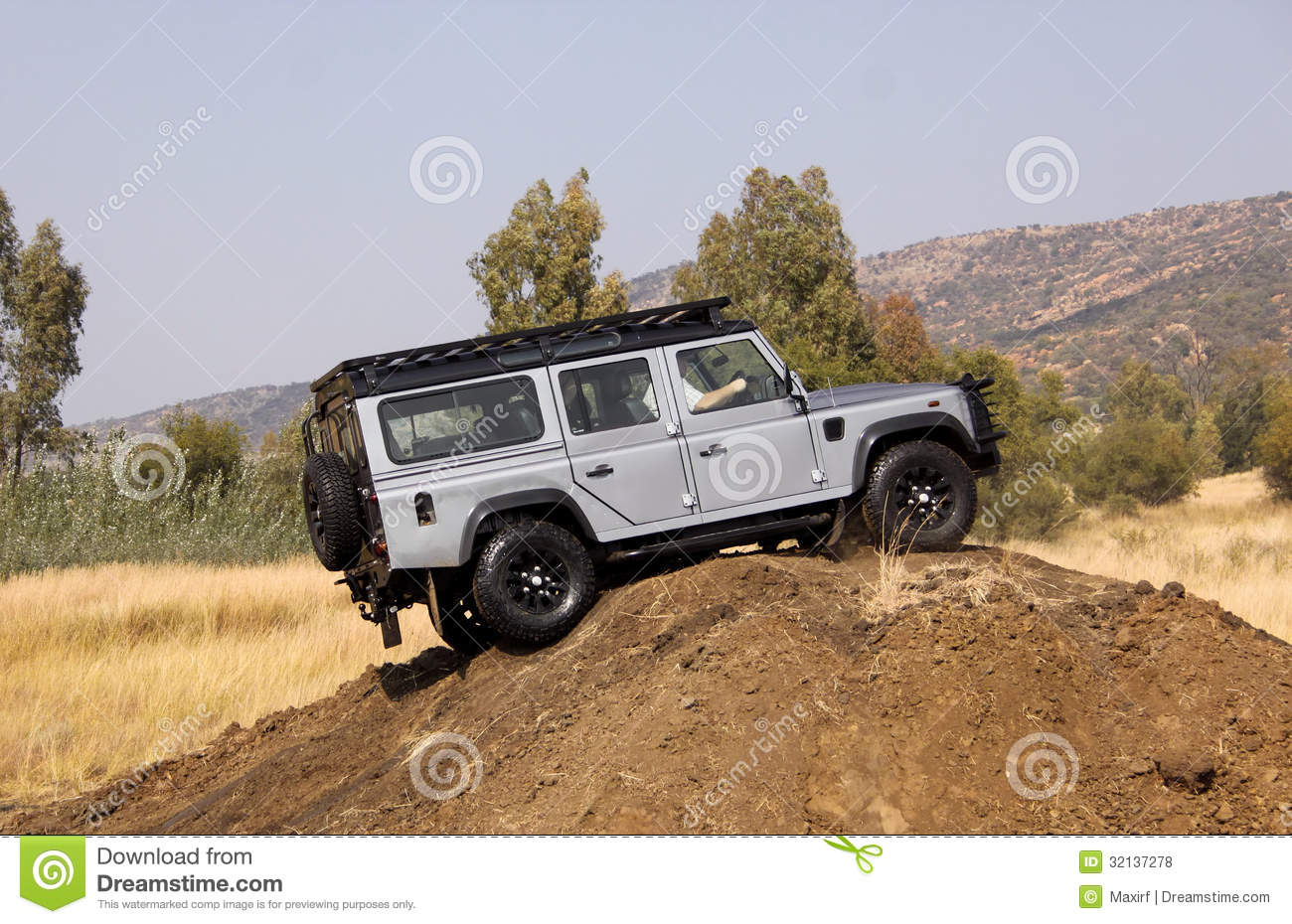 silver land rover defender 110 sw on 4x4 course editorial stock photo image 32137278. Black Bedroom Furniture Sets. Home Design Ideas