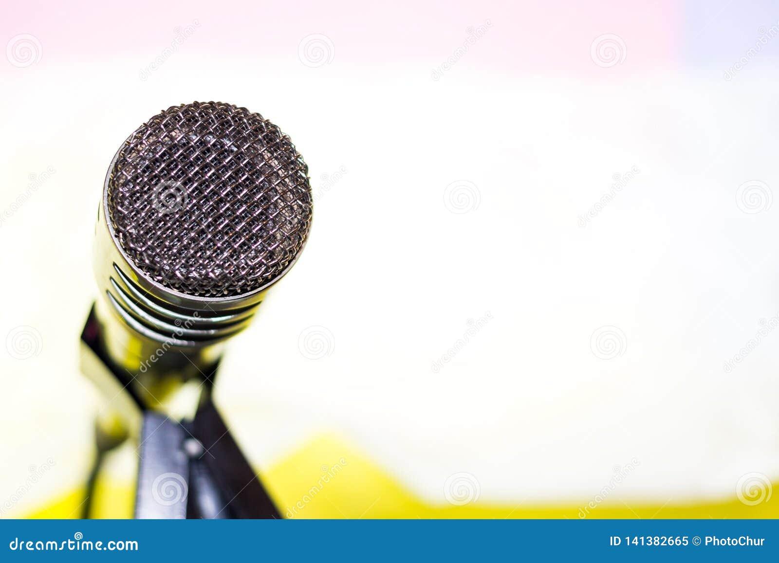 Silver microphone on rack closeup