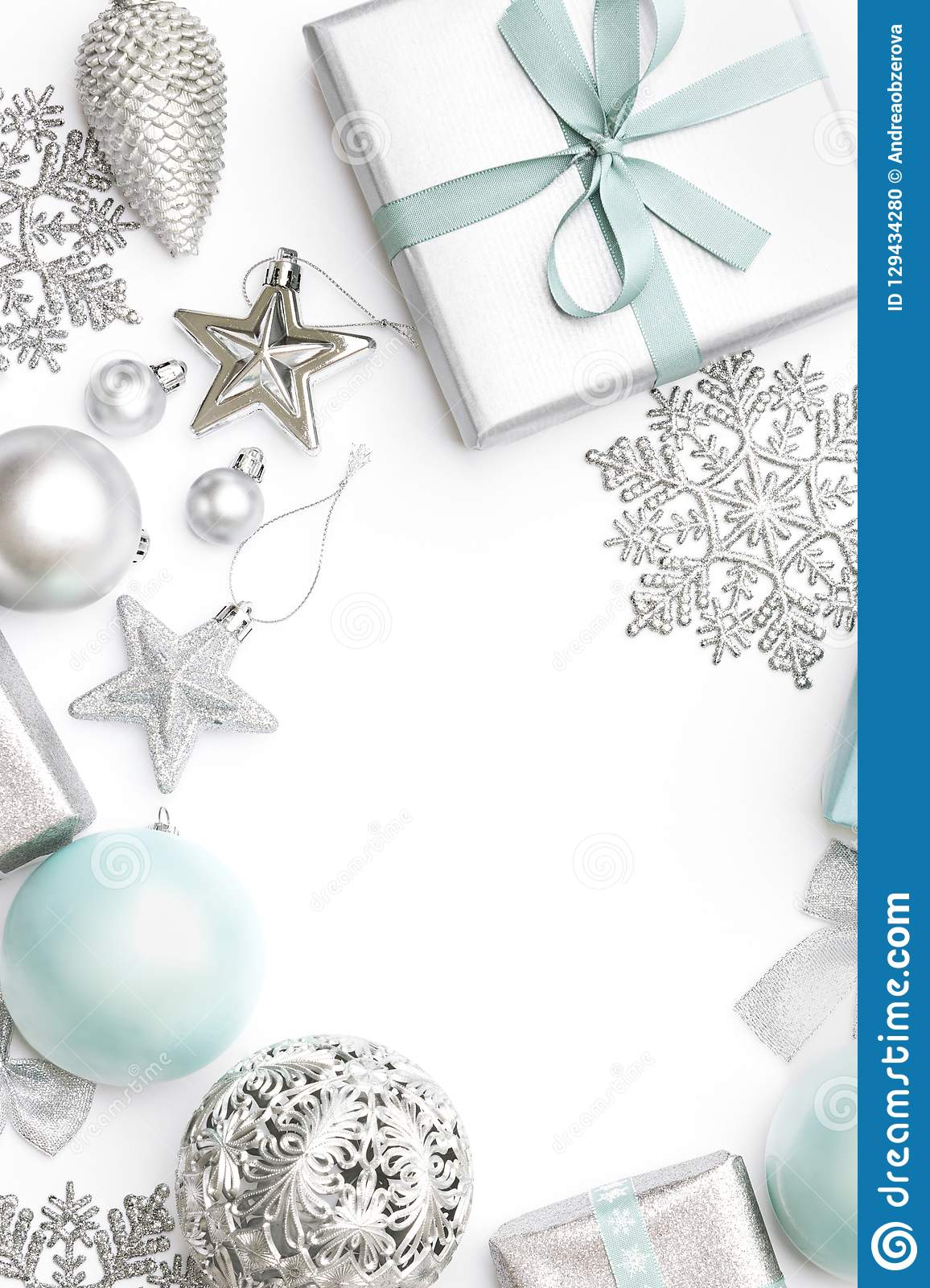 Silver and pastel blue christmas gifts, ornaments and decorations isolated on white background. Christmas border.
