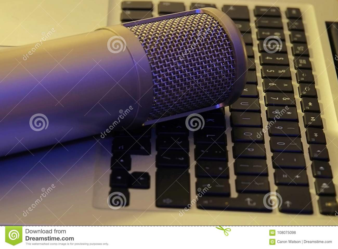 Podcast Microphone on laptop computer keyboard