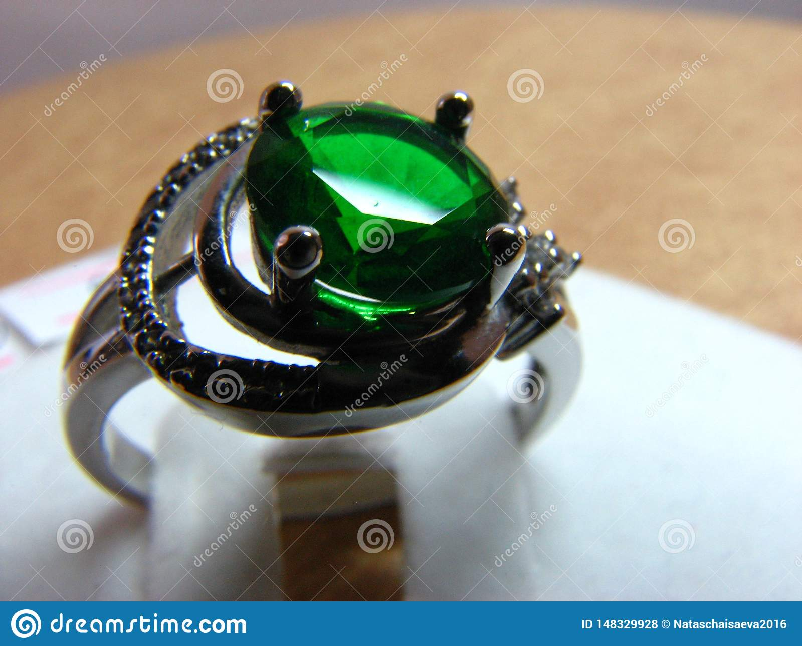 Silver ring with emerald stone