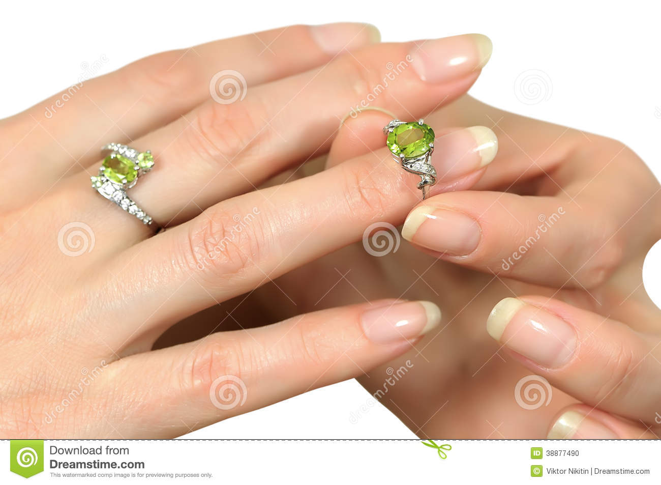 Donning a silver ring with a precious stone peridot ring finger on a ...