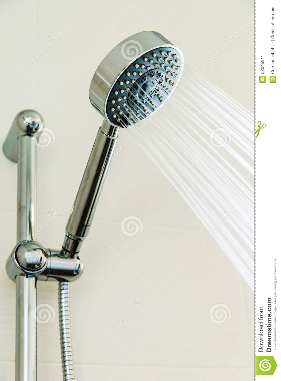 Silver Shower Head In Bathroom With Water Drops Flowing Bathroom