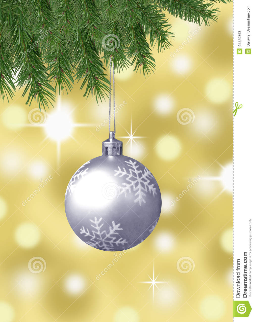 Silver snowflake christmas balls with abstract bokeh background and pine branches