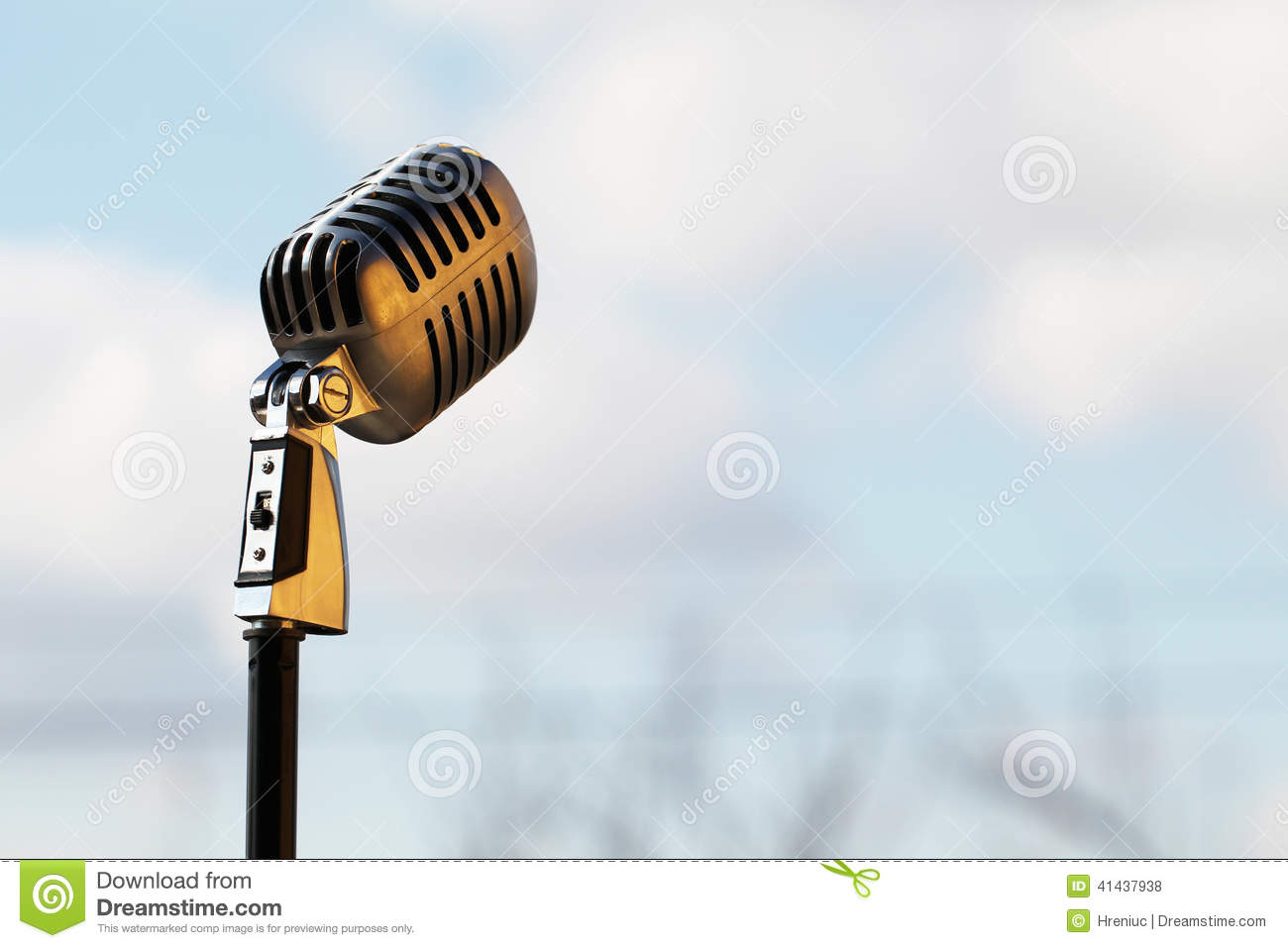 Silver vintage microphone in the studio on outdoor background