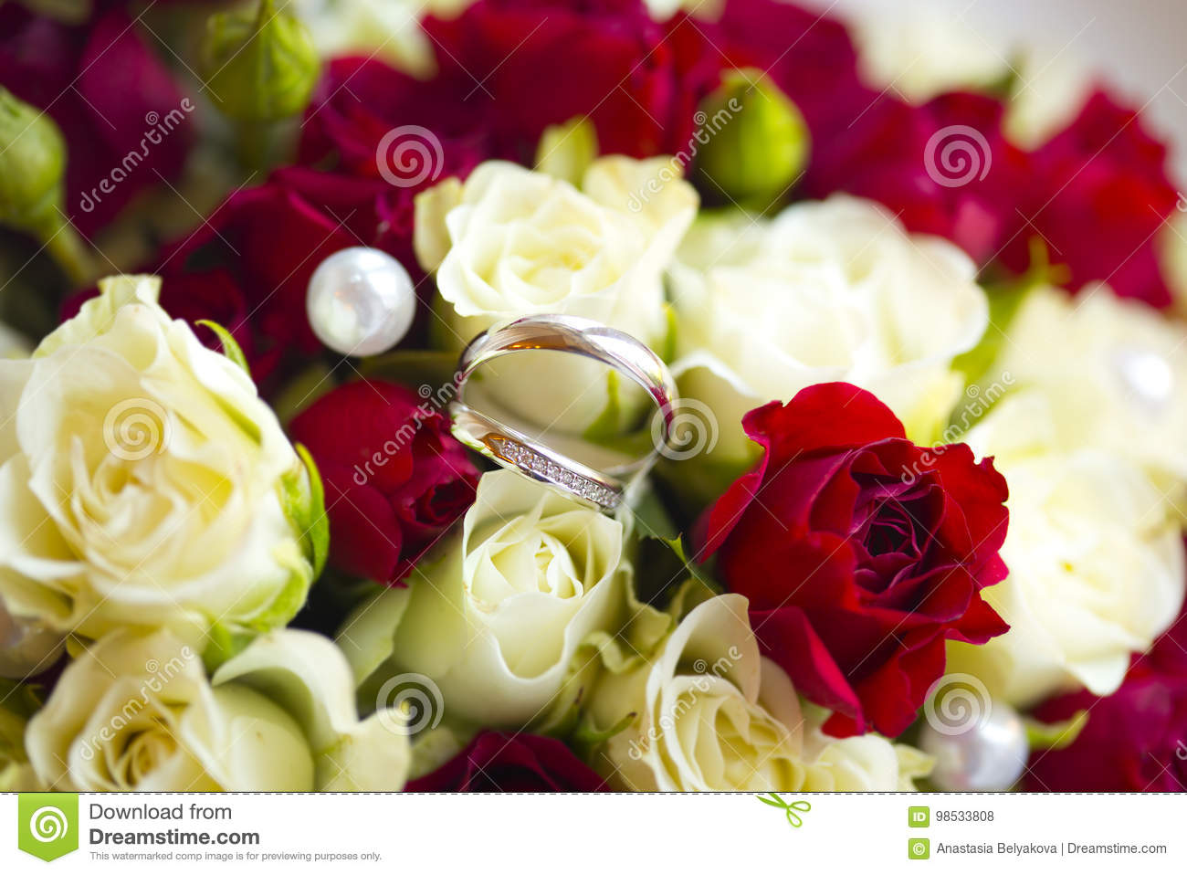 Silver Wedding Rings On Wedding Bouquet Stock Photo Image Of Roses