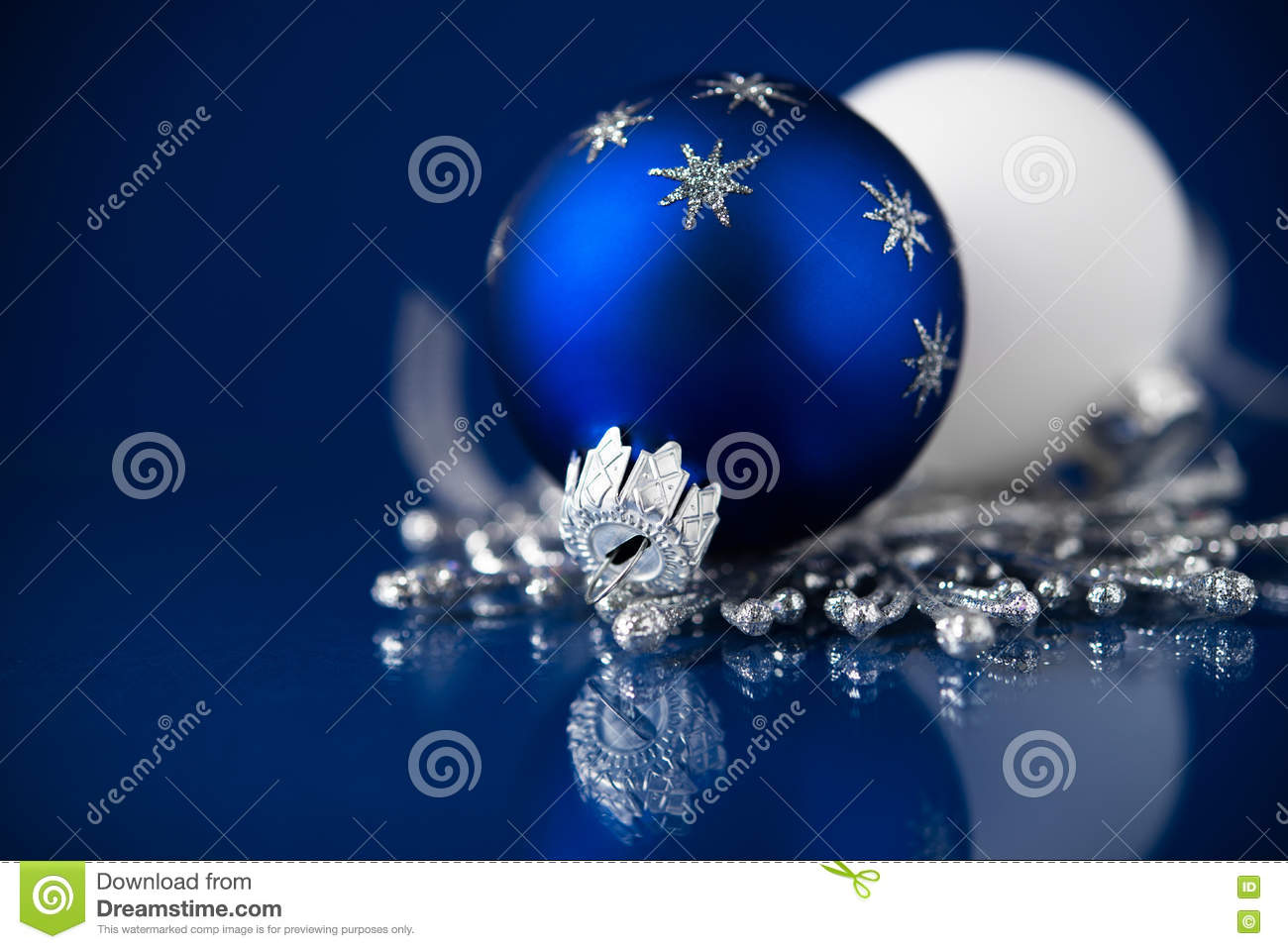 silver white and blue christmas ornaments on dark blue background merry christmas card - Navy Blue Christmas Decorations