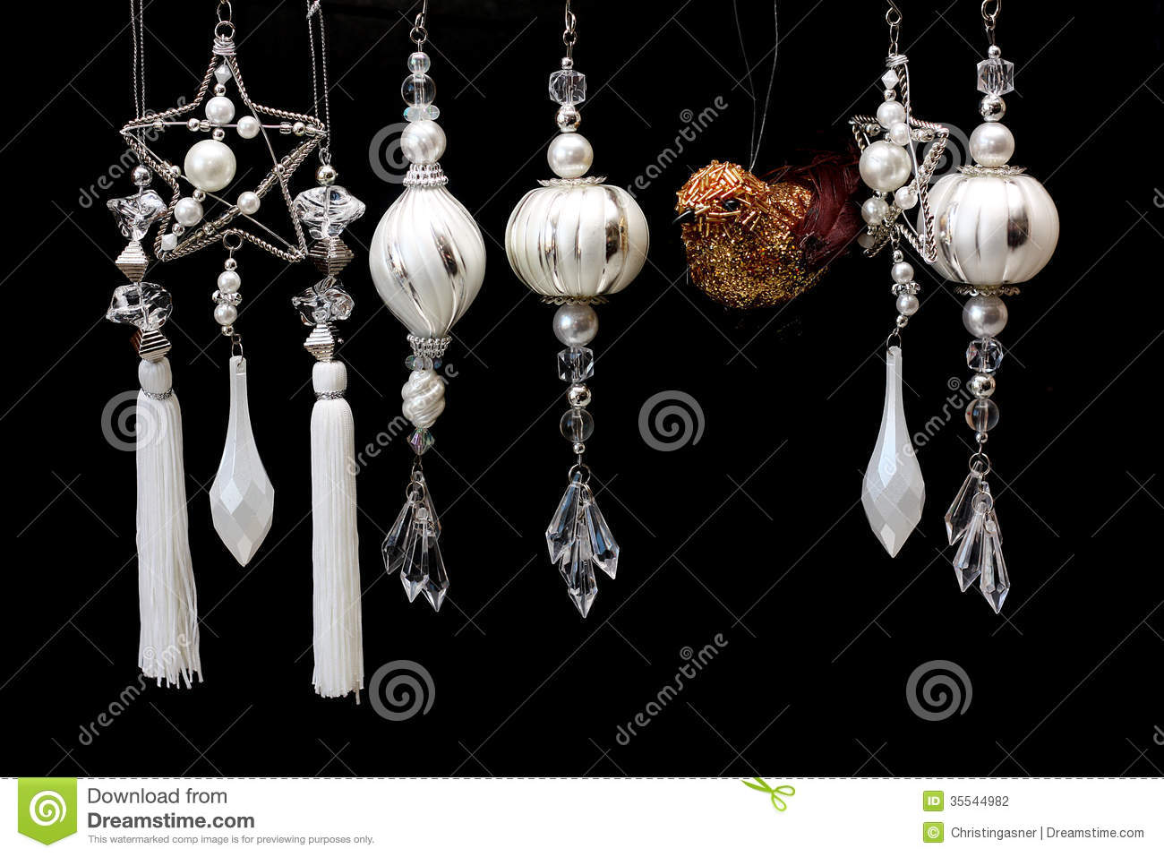 Silver And White Christmas Tree Ornaments On Black Stock Photo