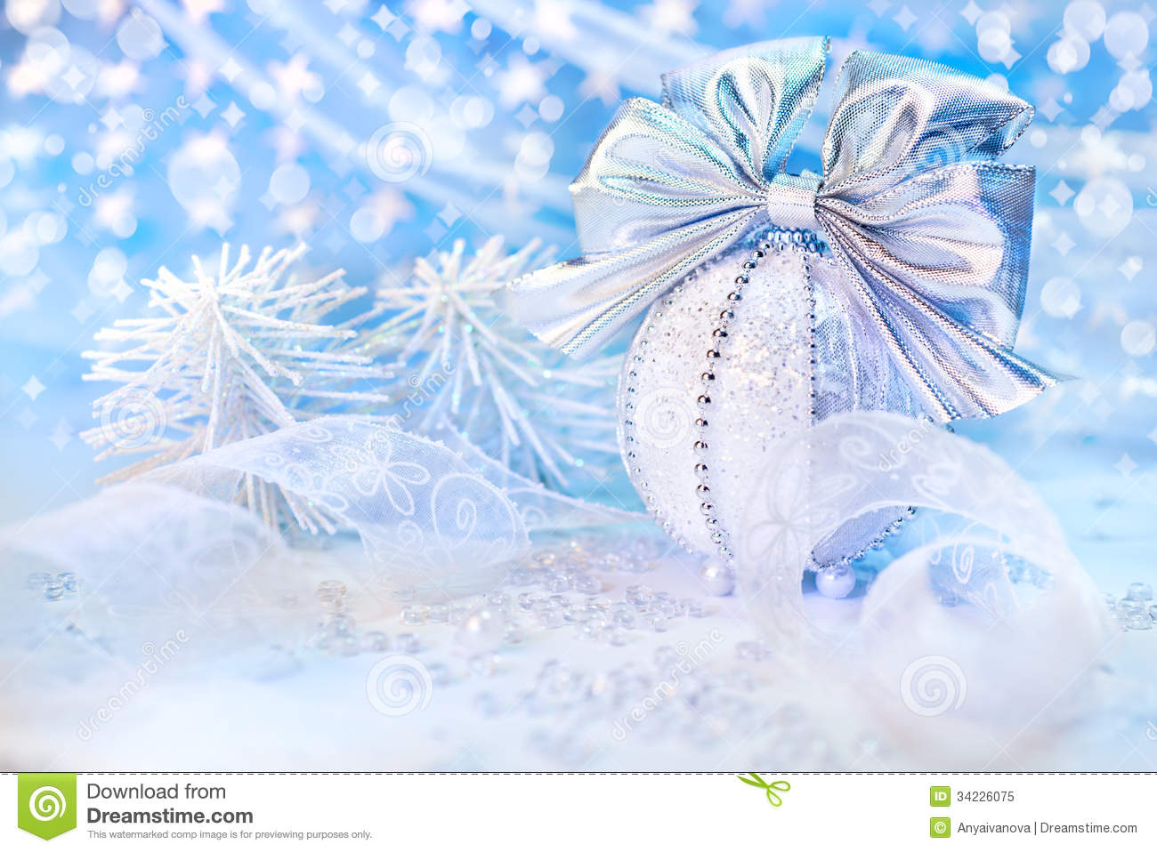 White and silver christmas decorations on abstract winter background