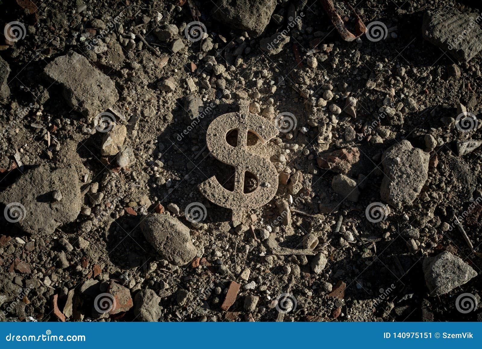 Simbolo del dollaro su sporcizia o su detriti