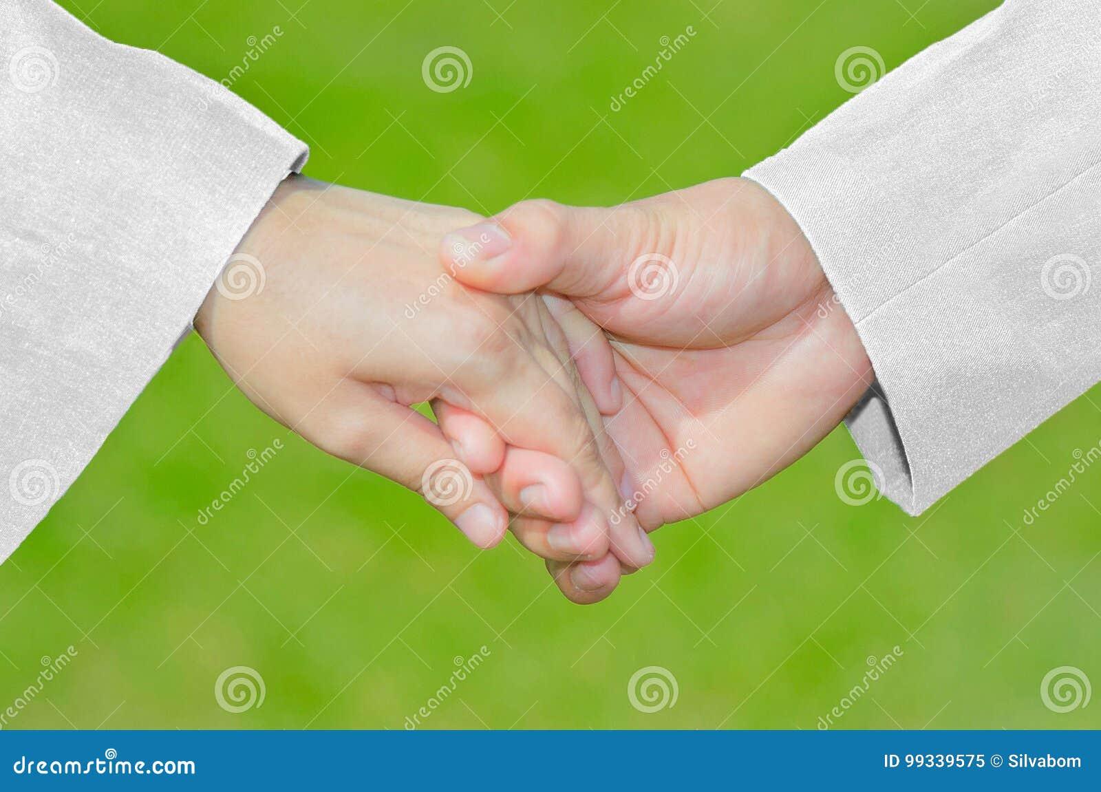 Simbolo di cura di amore, mano con Suit&Dress bianco, sesso della tenuta della mano,