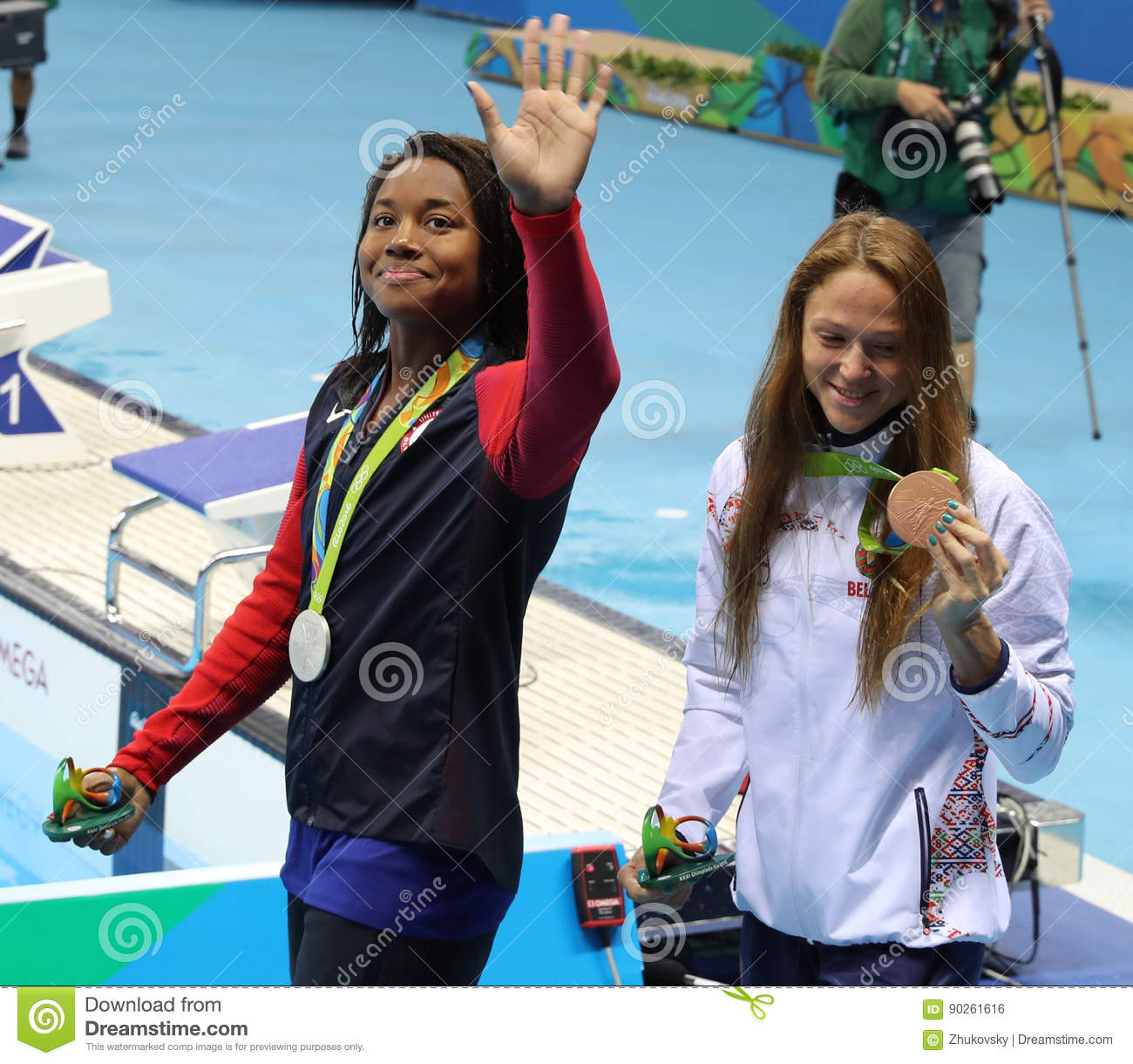 Simone Manuel of USA and Aliaksandra Herasimenia of Belarus during medal ceremony after Women`s 50m freestyle of the Rio 2016