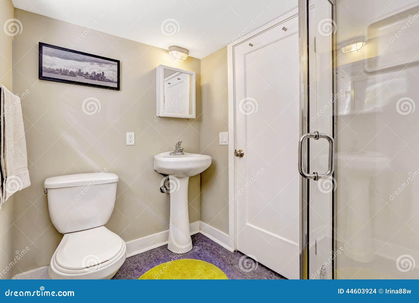 simple bathroom interior with purple floor and light beige walls