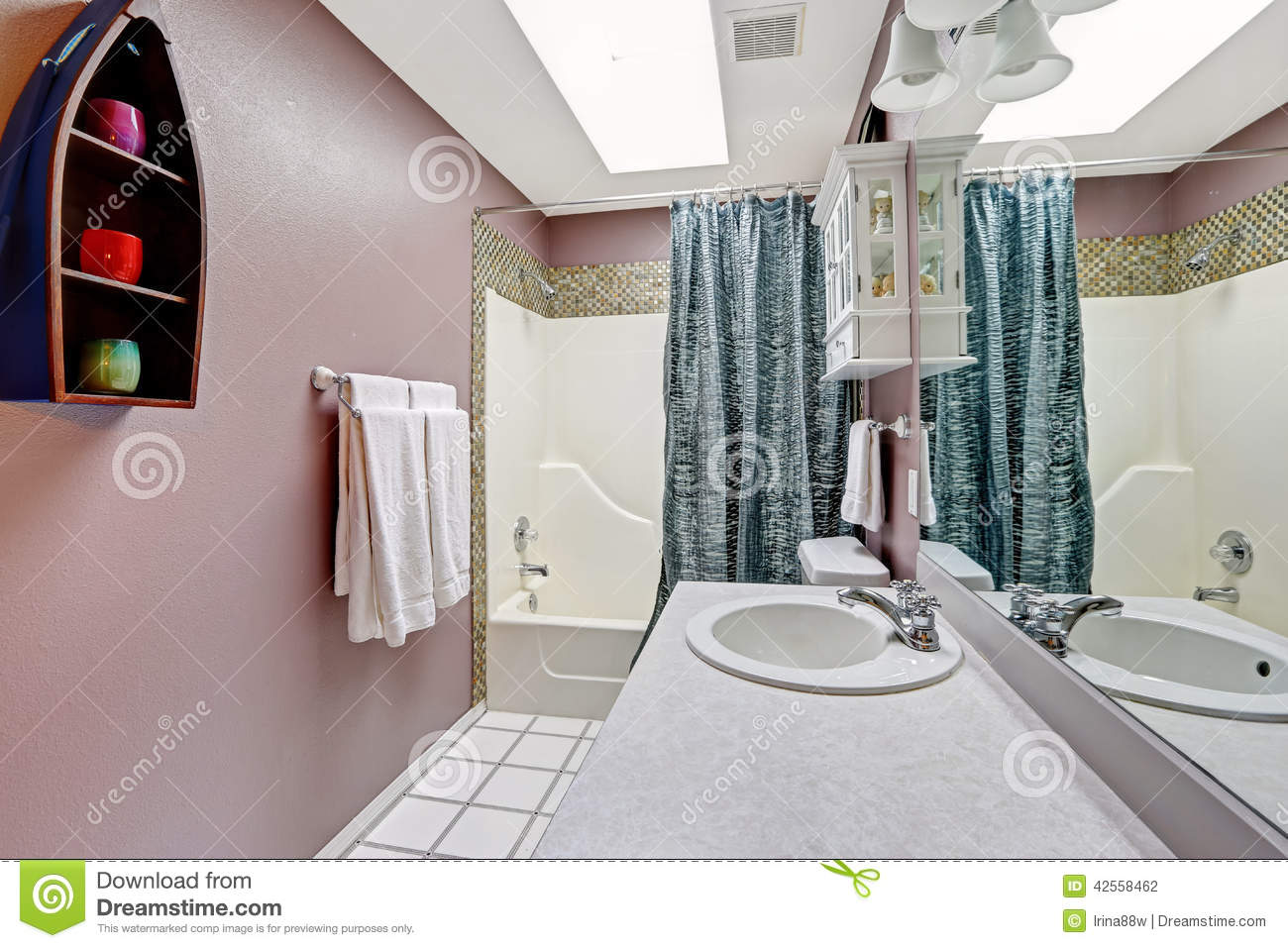 Simple bathroom intrerior in mauve color with skylight Mauve bathroom