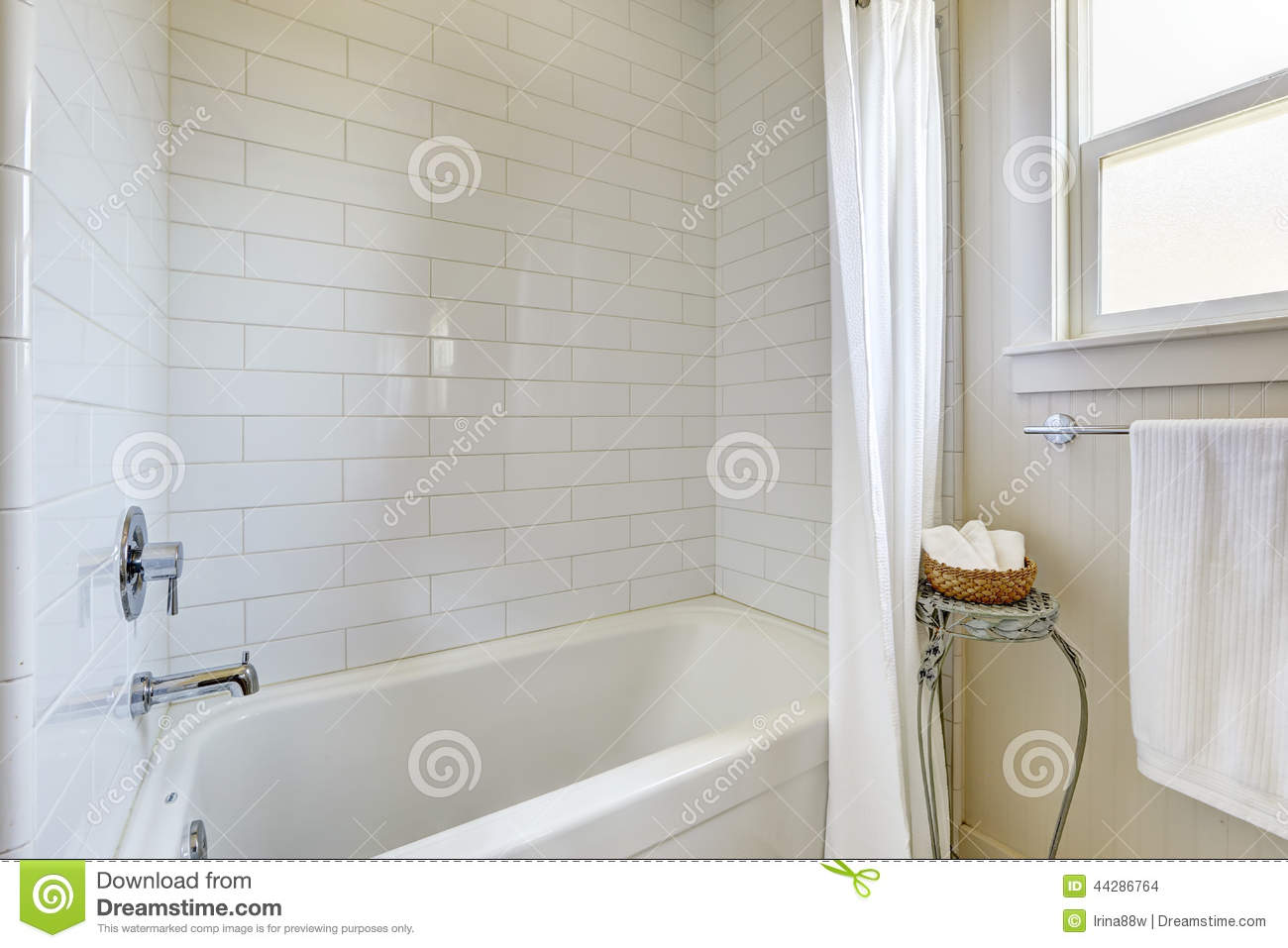 Simple Bathroom With Tile Wall Trim And Bath Tub Stock Photo - Image ...