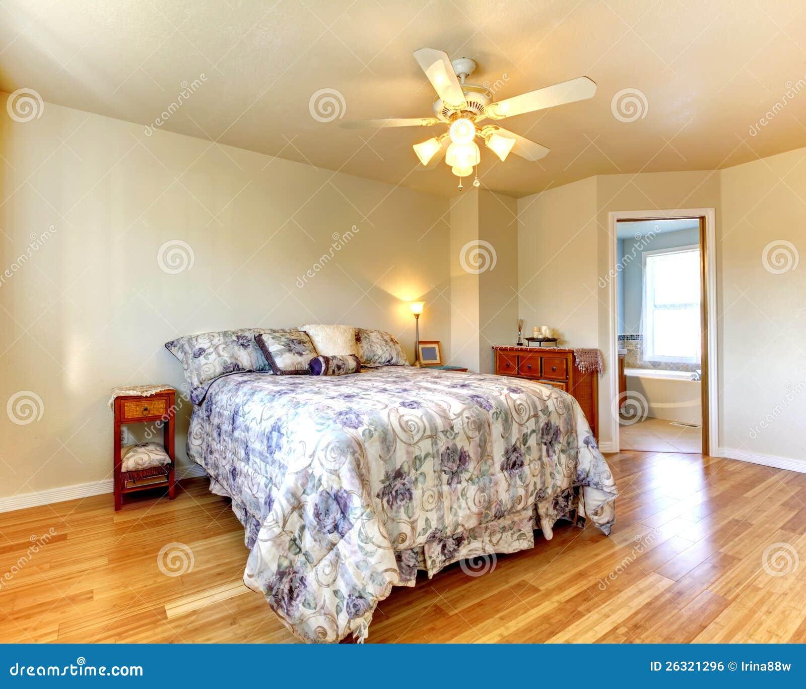 Bedroom Floor Tiles Bedroom Bedsheets Bedroom Yellow And Green Bedroom Bay Window Seat: Simple Bedroom With Flowery Bedding And Hardwood Floor