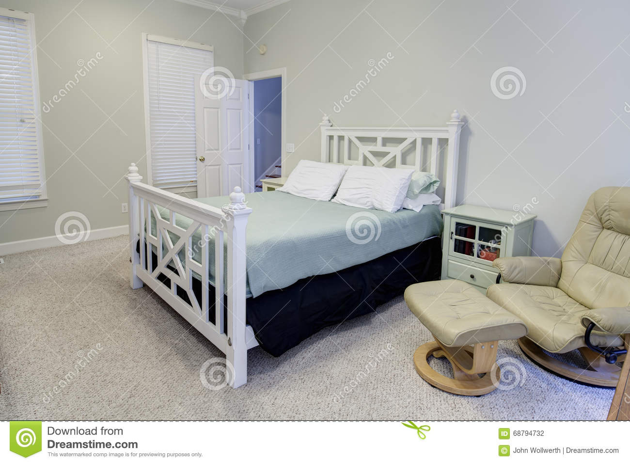 Simple bedroom in neutral colors stock photo image 68794732 for Bright neutral paint colors