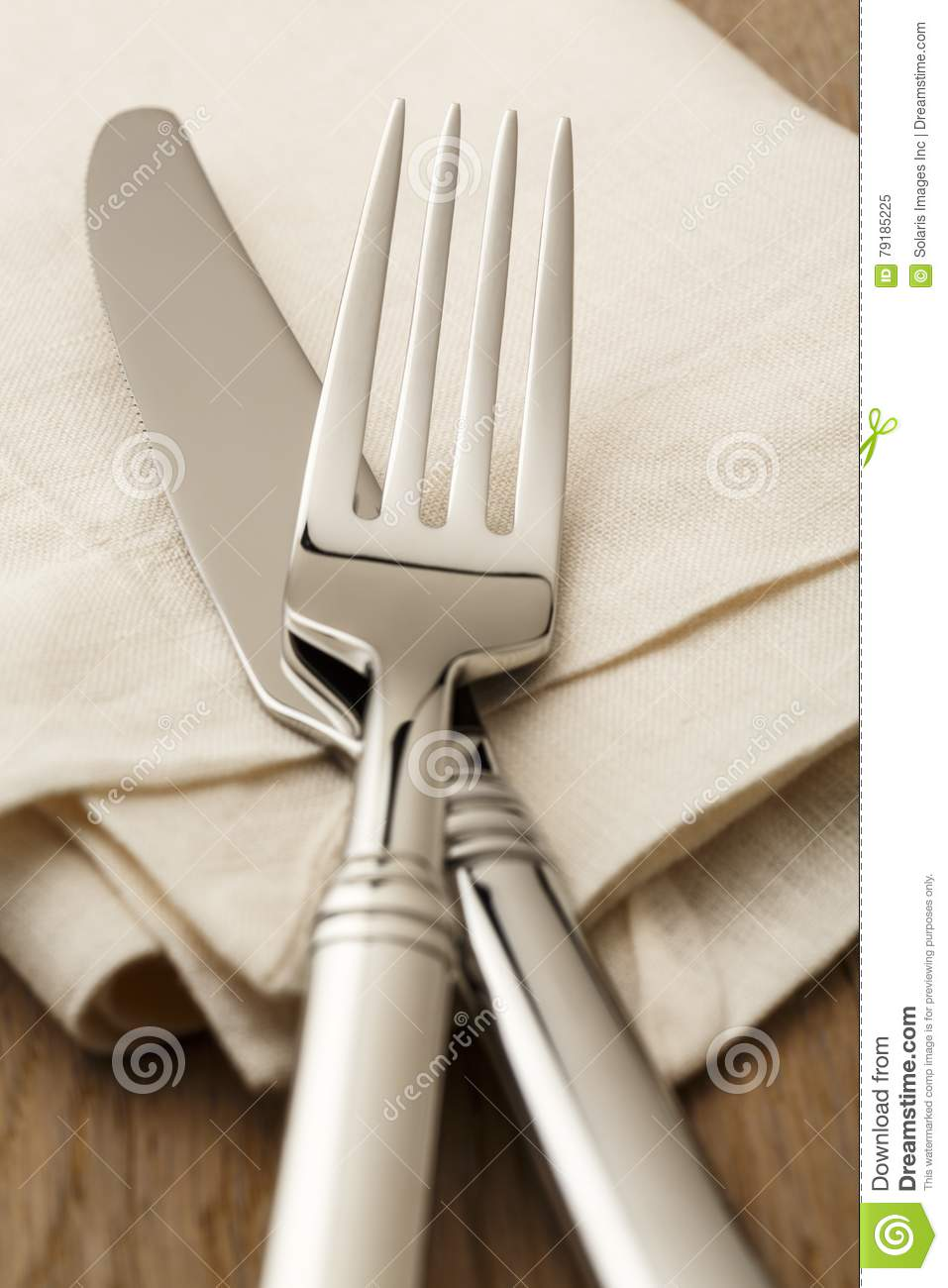 High quality fork and knife lay on an ivory linen napkin on a wood table. Casual fine dining concept. & Simple Classic Table Setting Place Setting With High Quality ...