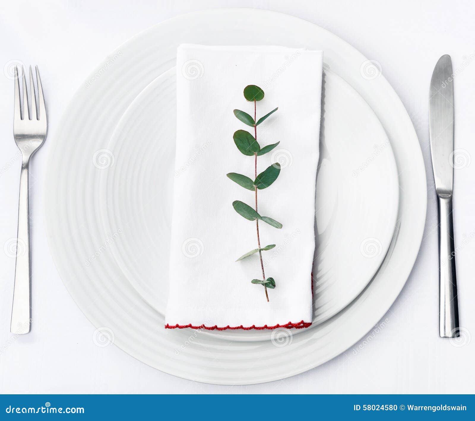 Simple Dinner Setting, Green Stem On Napkin With Plain Crockery Stock ...