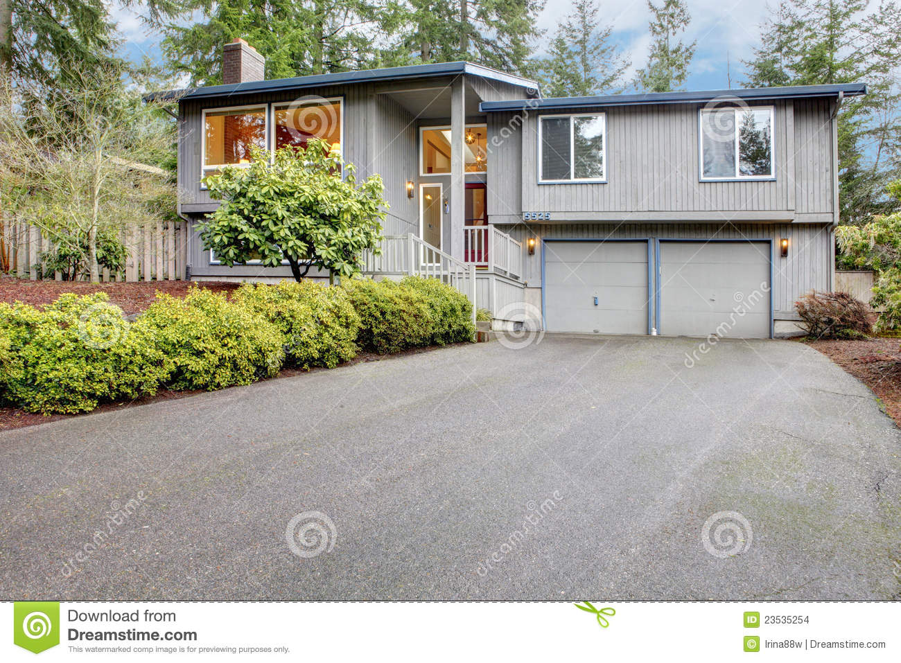 Simple grey brown split level american house stock photo for Simple american house