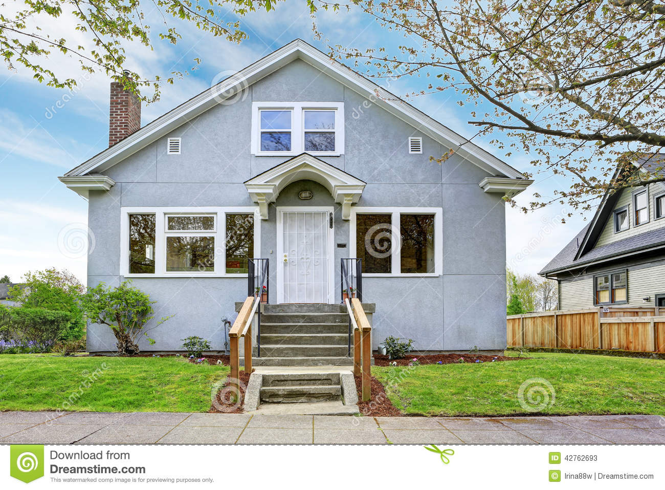 Simple home exterior simple house exterior view of entrance porch and walkway stock photo