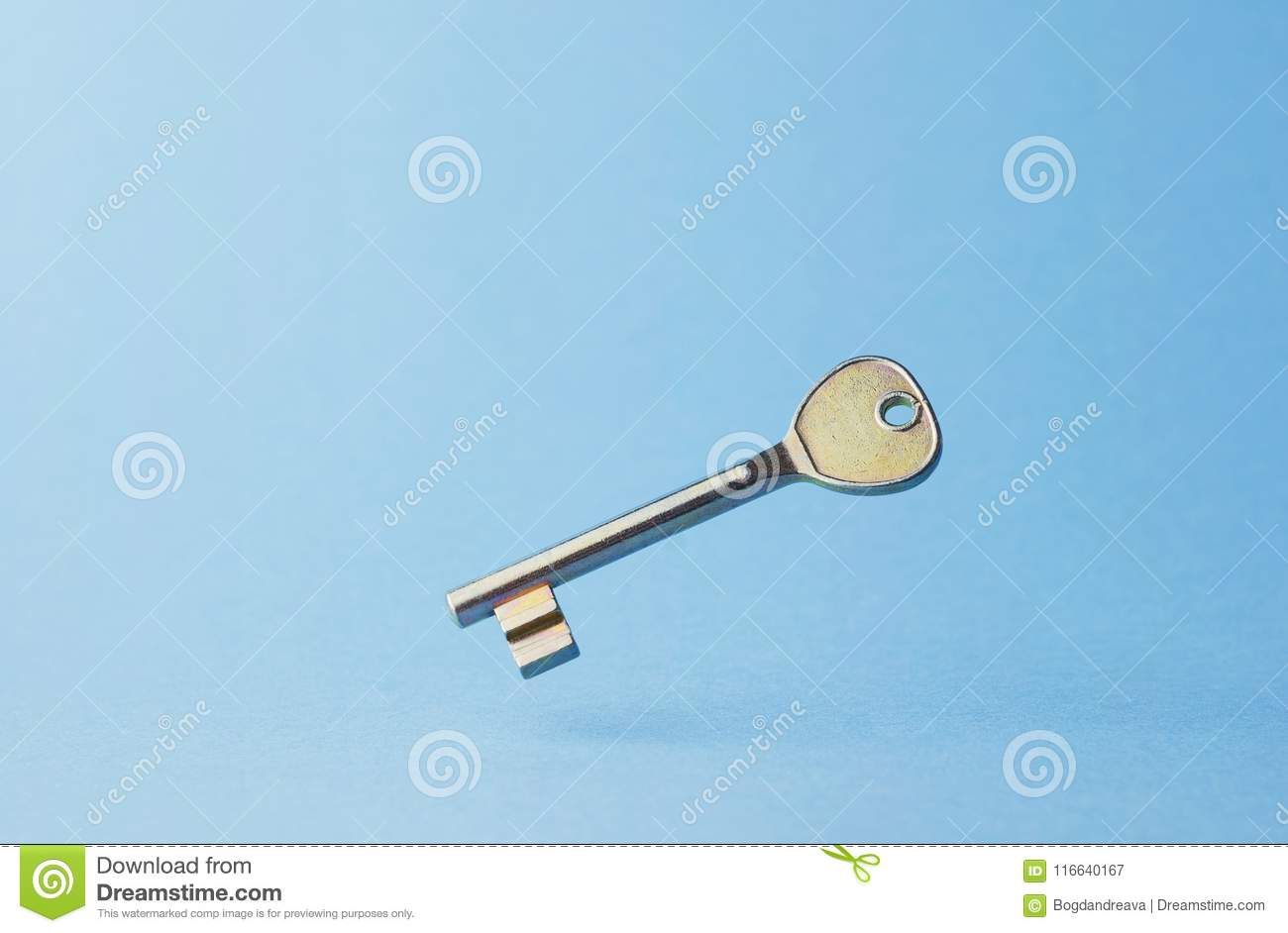 Simple Door Key Floating In The Air Over Blue Background