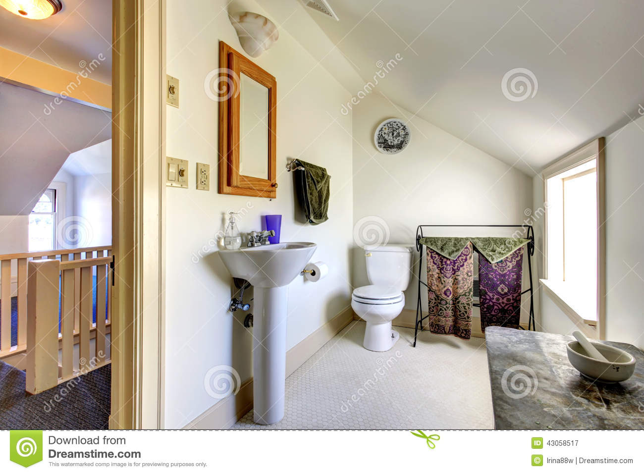 Bathroom Lighting Vaulted Ceiling simple light tone bathroom with vaulted ceiling stock photo