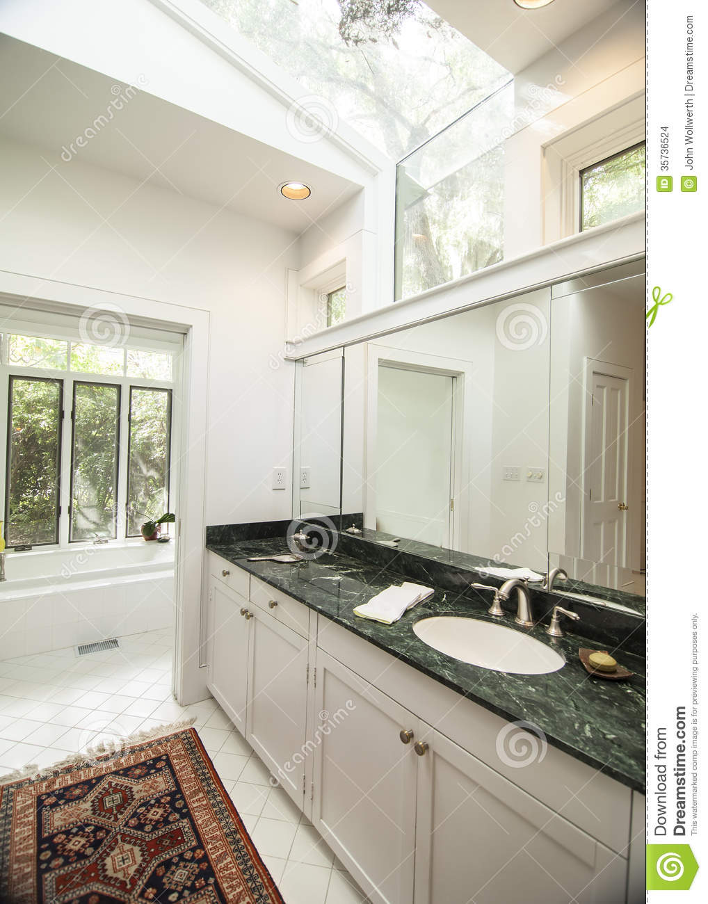 Simple Modern Bathroom With Black Granite Counter Stock Photo ...