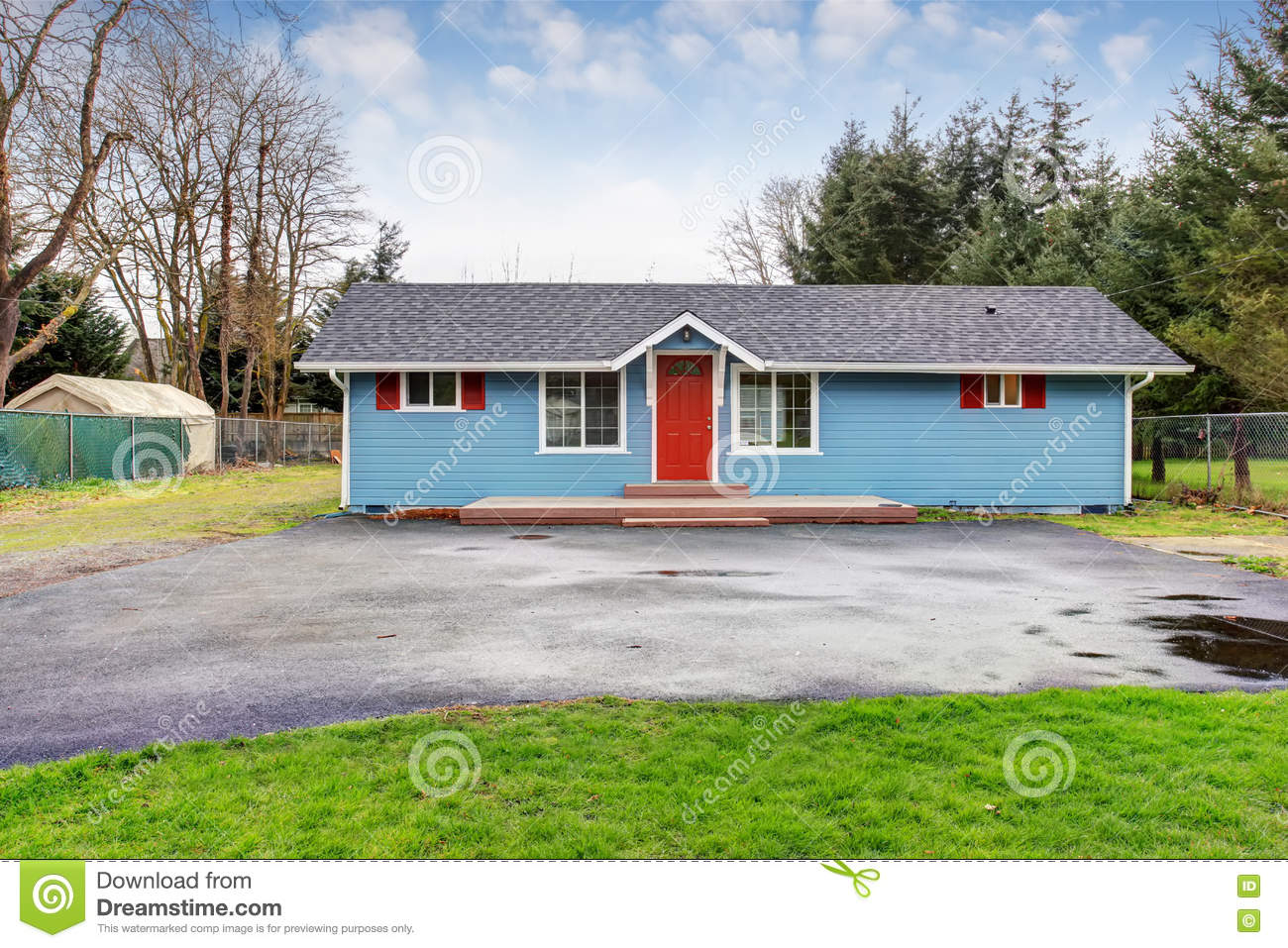 simple one story house exterior with blue and red trim stock photo simple one story house exterior with blue and red trim royalty free stock photo